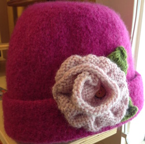 A felted hat with a knitted flower